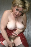 Caro is a mature busty granny from Germany with a natural hairy pussy