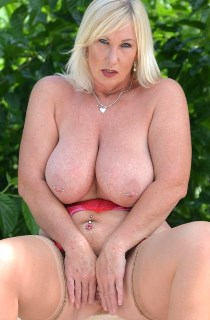 Melody - Melody is the perfect British MILF. A bisexual exhibitionist with mouthwatering 32FF tits. Get your hands on her NOW