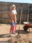 Adonna. Granny working in the yard Free Pic