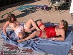 Devlynn. Devlynn & Candi's Squirting Match Free Pic 9