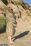 SpeedyBee. Fur Coat On The Beach Free Pic 2