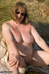 SpeedyBee. Fur Coat On The Beach Free Pic 19