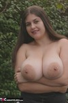 DeniseDavies. Flashing my big tits in the garden Free Pic 7