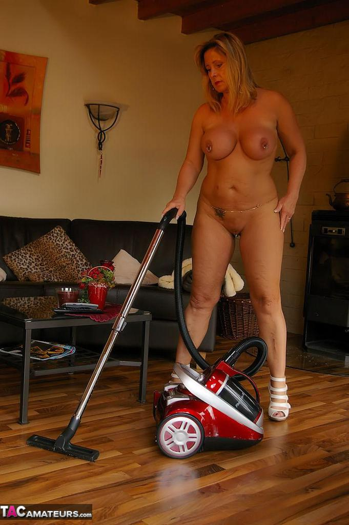 Horny housewife doing housework naked