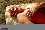 Dimonty. Red Sunbathing Free Pic 3