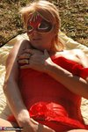 Dimonty. Red Sunbathing Free Pic 4