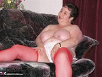 KinkyCarol. Slut In Red & White Free Pic