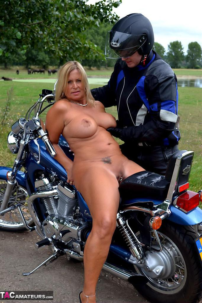 Naked motorcycle babe revs up russia