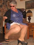 Girdle Goddess. Sunglasses, Gloves & Smoking Free Pic 5