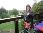 Barby. Thigh High & Biker Jacket Flashing Free Pic 4