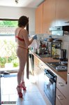 HotMilf. Red Hot In The Kitchen Hard At Work Free Pic