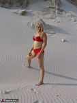 Sweet Susi. Red Lingerie in the sand Free Pic 1