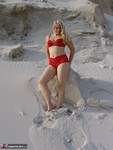Sweet Susi. Red Lingerie in the sand Free Pic 2
