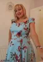 . Whats beneath my blue dress Free Pic 1