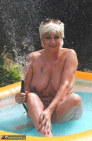 Dimonty. Playing Naked In My Paddling Pool Free Pic 7