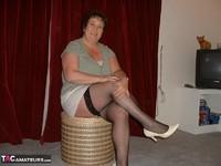 Kinky Carol. White Mini & Black Stockings Pt1 Free Pic 2