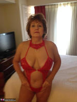 Busty Bliss. Hotel Fun - Red PVC & Bellboy Cock Pt1 Free Pic 1
