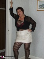 KinkyCarol. Leather Mini & Body Stocking Free Pic 1