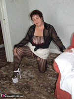 KinkyCarol. Leather Mini & Body Stocking Free Pic 3