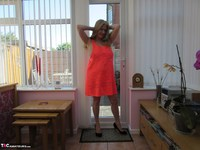 Lily May. Lily In Her Little Orange Dress Free Pic 1