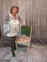 . Posing With The Chair Free Pic 1