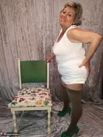 . Posing With The Chair Free Pic 9