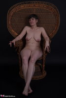 Hot Milf. In The Wicker Chair Free Pic 1