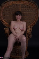 Hot Milf. In The Wicker Chair Free Pic 7