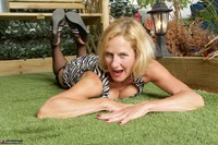 Molly MILF. In The Garden Free Pic 4