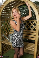 Molly MILF. In The Garden Free Pic 11
