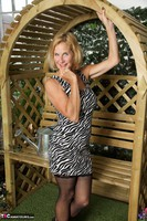 Molly MILF. In The Garden Free Pic 16