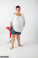 Tattoo Girl. Red Stool Free Pic 1