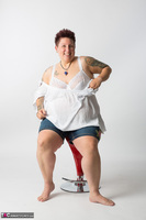 Tattoo Girl. Red Stool Free Pic 6