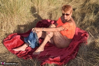 . Stripping In The Dunes Free Pic 3