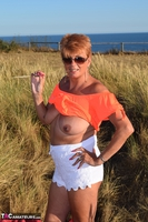 . Stripping In The Dunes Free Pic 7
