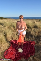 . Stripping In The Dunes Free Pic 9