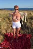 . Stripping In The Dunes Free Pic 10