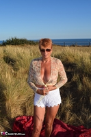 . Stripping In The Dunes Free Pic 12
