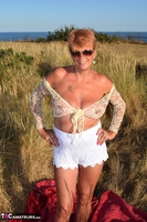 . Stripping In The Dunes Free Pic 13