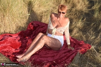 . Stripping In The Dunes Free Pic 14
