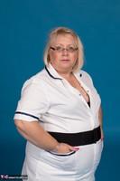 Lexie Cummings. Sexy Nurse Lexie Strips Free Pic 1
