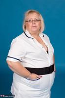 Lexie Cummings. Sexy Nurse Lexie Strips Free Pic 2