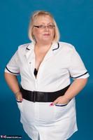Lexie Cummings. Sexy Nurse Lexie Strips Free Pic 3