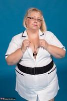 Lexie Cummings. Sexy Nurse Lexie Strips Free Pic 4