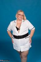 Lexie Cummings. Sexy Nurse Lexie Strips Free Pic 6