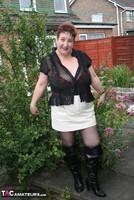 Kinky Carol. Black Boots & White Mini Pt1 Free Pic 5