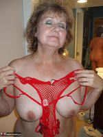Busty Bliss. Red Fishnet Teddy Free Pic 1