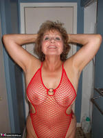 Busty Bliss. Red Fishnet Teddy Free Pic 5