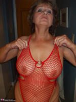 Busty Bliss. Red Fishnet Teddy Free Pic 7