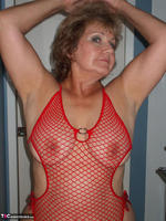 Busty Bliss. Red Fishnet Teddy Free Pic 8